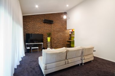 Renovated 70s exposed brick wall apartment living room