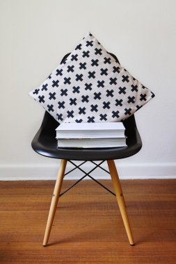 Contemporary black dining chair with modern crosses cushion