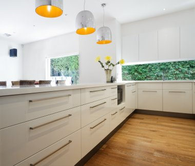 Cabinetry drawers in a new contemporary white kitchen renovation