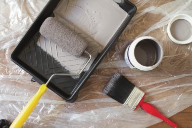 Overhead view of home painting equipment brush  roller tray
