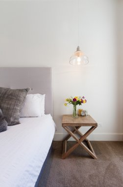 Hamptons styled bedside table with hanging pendant light in luxu