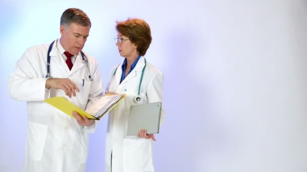 two doctors going over charts with copy space