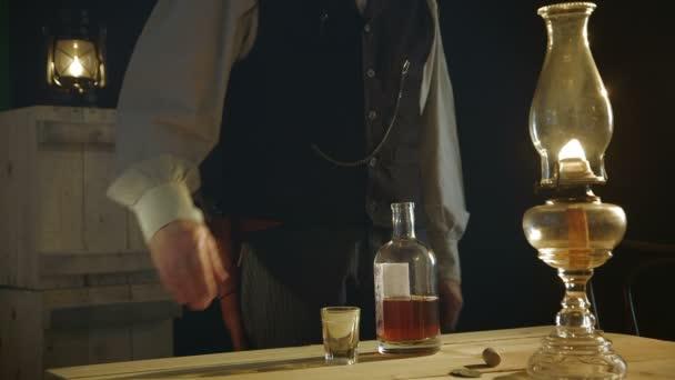 cowboy walks in pours drink