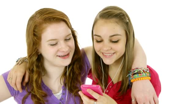 teenage girls listening to music smile at camera