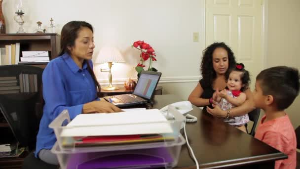 hispanic businesswoman has her client sign papers