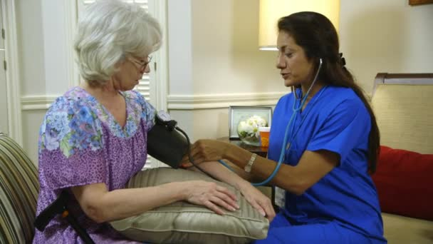 home healthcare nurse starts taking blood pressure of her patient