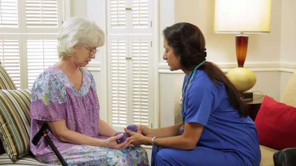 home healthcare nurse helping her patient exercise