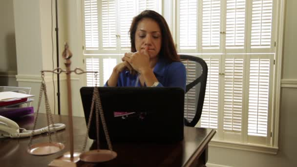 hispanic woman attorney gets handed a folder by assistant