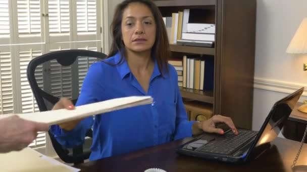 hispanic woman ceo gets a folder from her assistant 4k