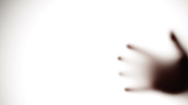 kísérteties kéz - matt üveg mögött