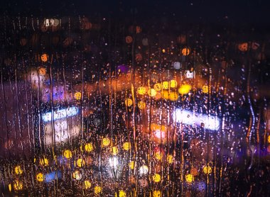 Night city lights behind  window