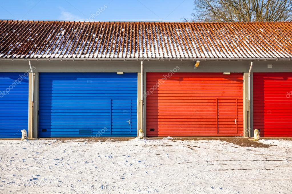 Blue And Red Garage Doors In Snow Stock Photo Creativenature