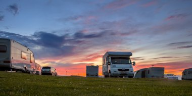Caravans and cars campsite sunset