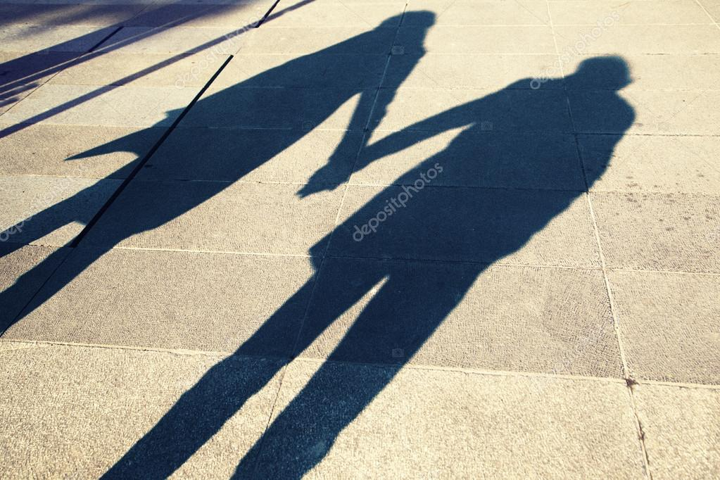 Shadow of two people holding hands on a walk — Stock Photo ... c5614917fb
