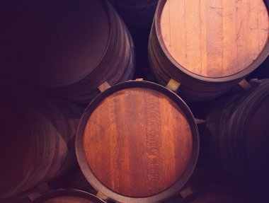 Row of wooden barrels of tawny portwine ( port wine ) in cellar, Porto