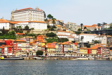 Colorful background, view of Douro riverside with the Dom Luiz bridge , Porto , Portugal. Travel background