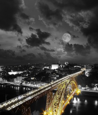 Full moon Golden Bridge on a monochromatic background, night view of the Dom Luiz bridge captured on a slow shutter, Porto , Portugal . Vintage picture