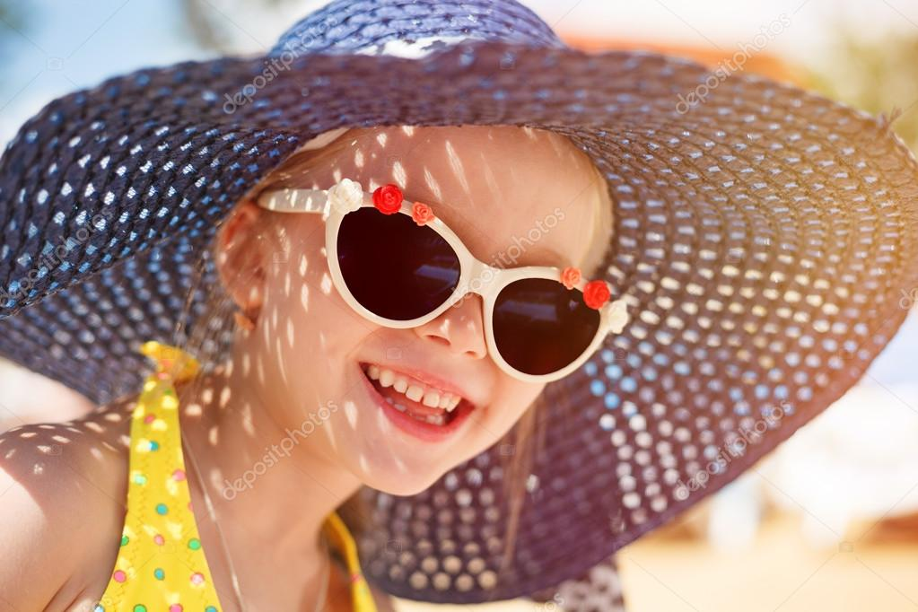 6168a9fcd7f2 Cute happy baby girl wearing swimming suit, sun glasses and hat, summer  vacation concept– stock image