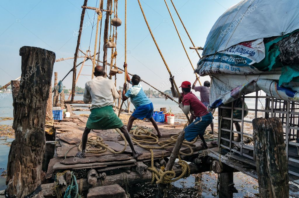 Fishermen pull out their Chinese fishing net from sea