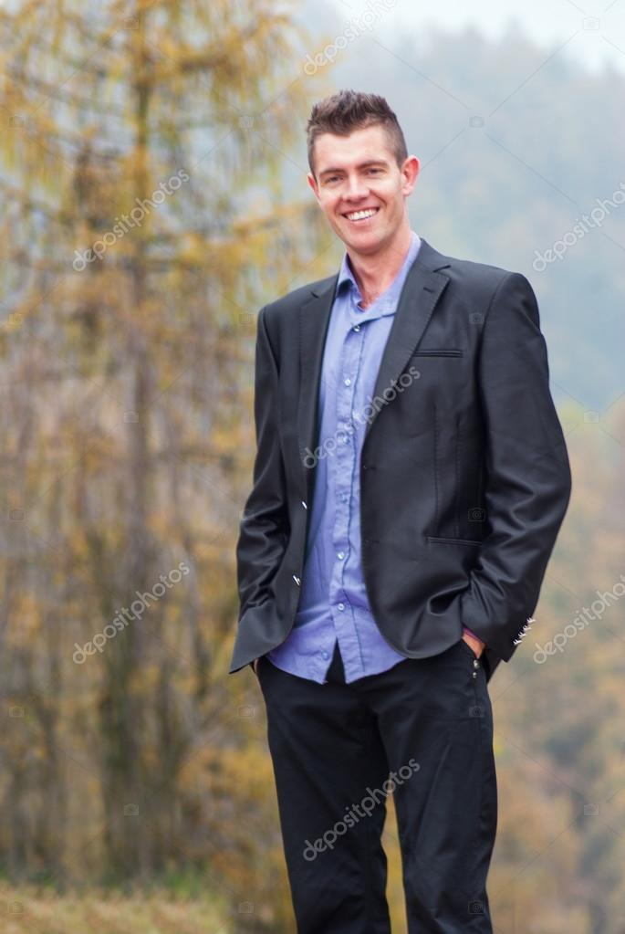 Handsome young businessman relaxing outdoor