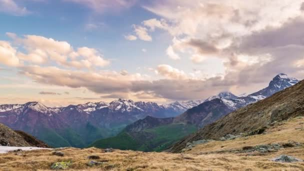 Timelapse view of snowcapped mountain ridges and peaks