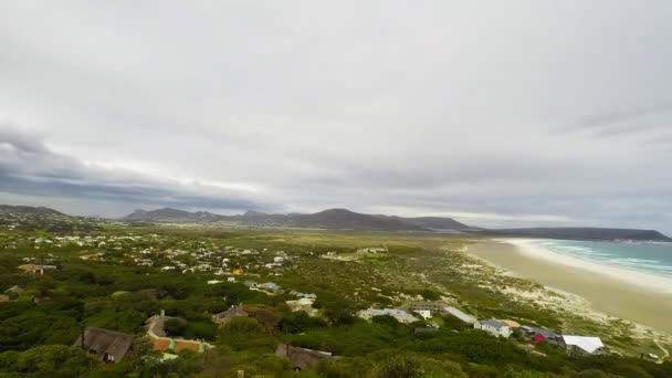 The scenic Noordhoek beach with dramatic sky in winter. 4k time lapse video of moving clouds from Chapmans Peak Drive, Cape Peninsula, Cape Town, South Africa.