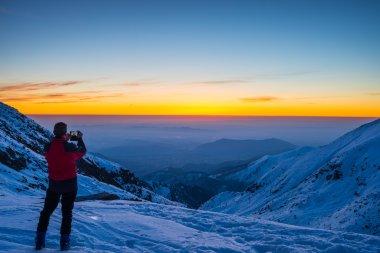 Alpinist taking selfie at twilight