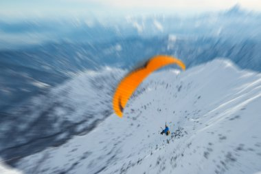 Paraglider flying over the Alps