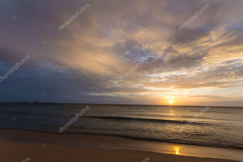 Golden sunrise on desert beach