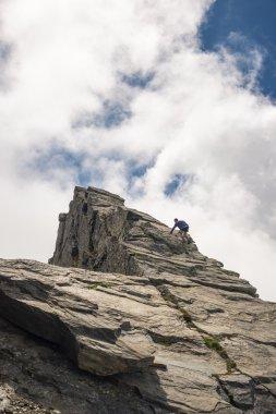 Free mountain climbing on steep rocky slope