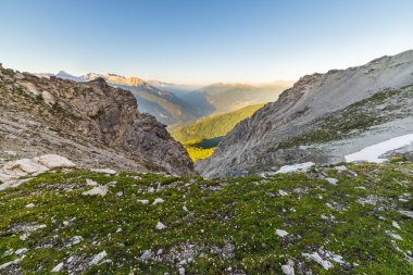 Glowing alpine valley and flowering meadow