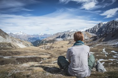 Woman resting on the mountain summit