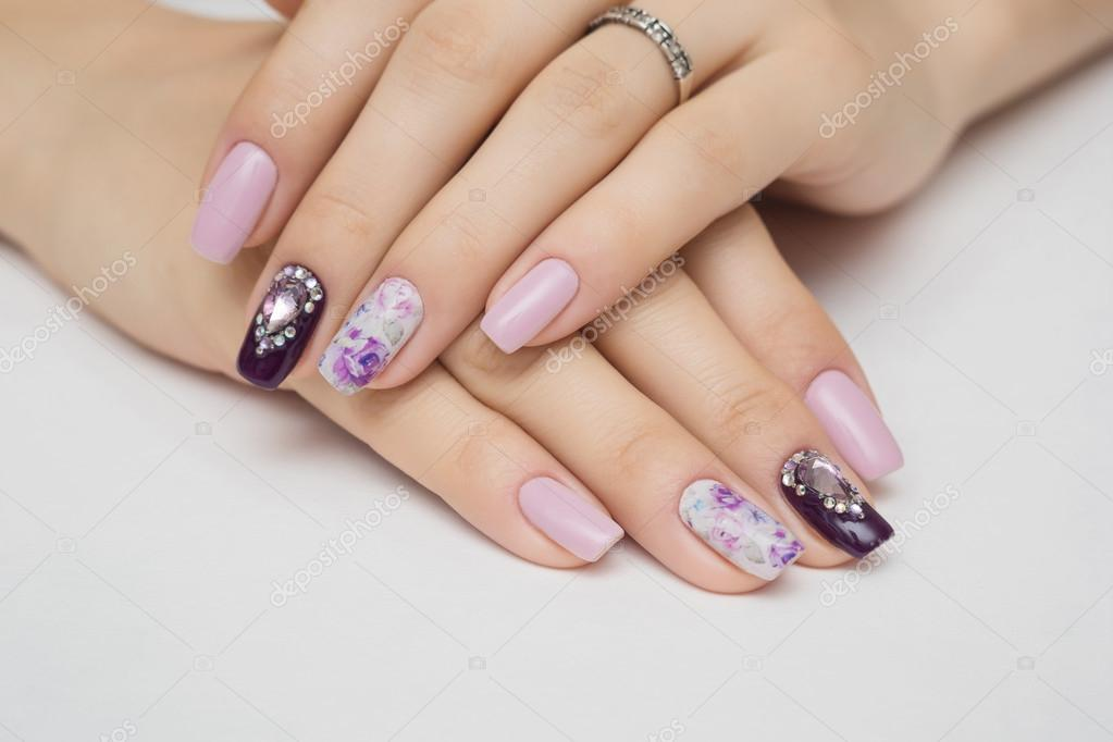 manicured nails with jewel on white background stock photo