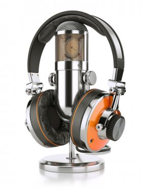 Professional studio microphone and headphones closeup, isolated