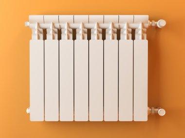 Heater radiator on yellow wall in house