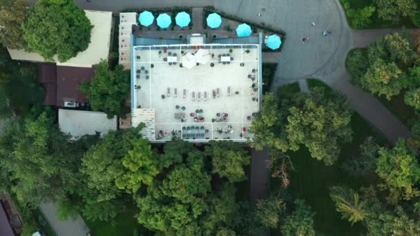 Summer terrace of the restaurant, people sit at tables. Aerial drone shot.