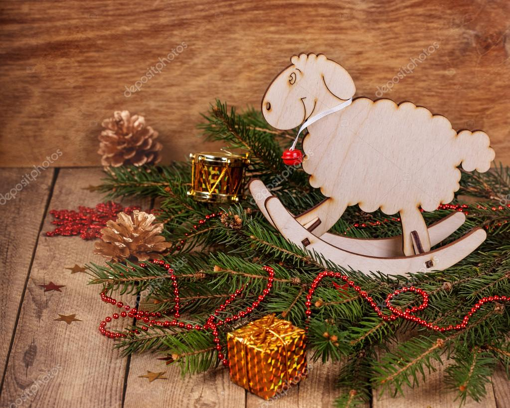 Christmas Composition With Fir Branches Wooden Toy A Sheep