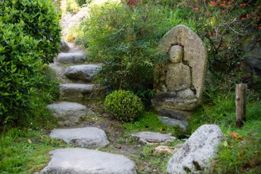 Calm oriental garden with a Buddha statue