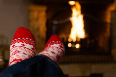 Christmas socks with a fire on the background