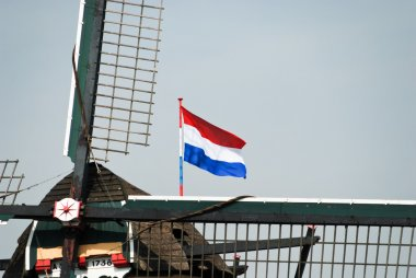 Typical Dutch windmill and national flag