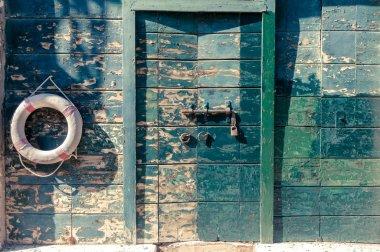 Life buoy on the old wooden paneled background