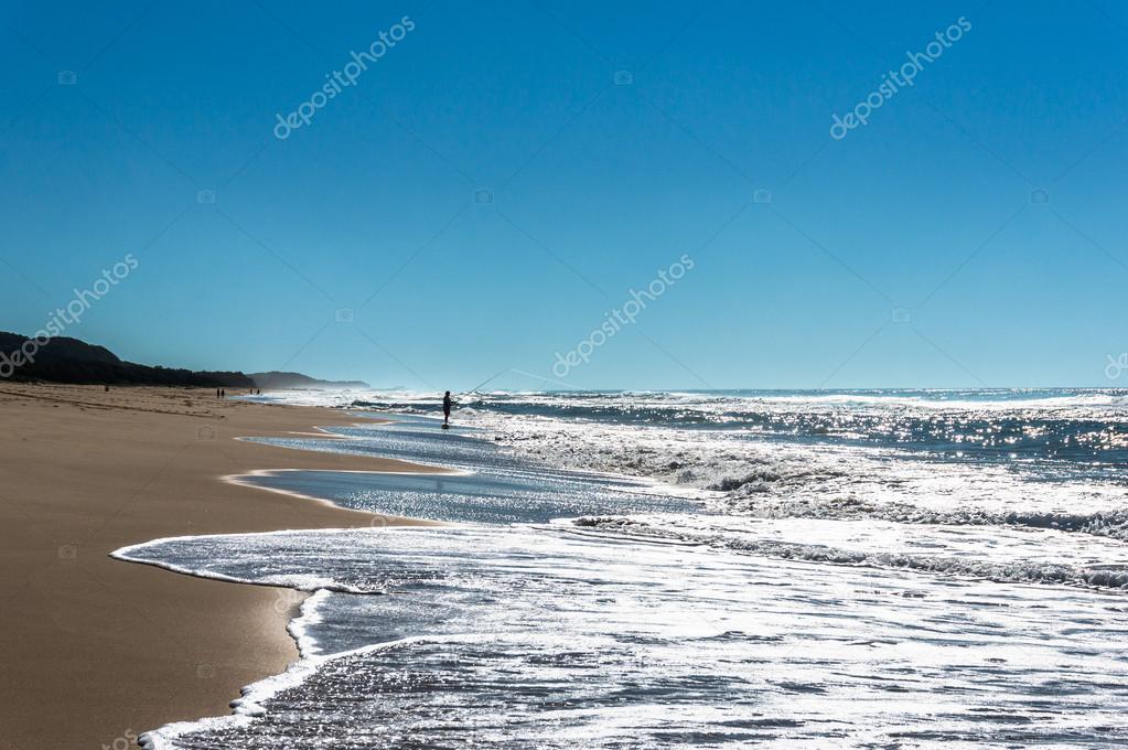 Sunlit ocean beach
