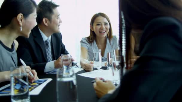 Asian business people having meeting in boardroom