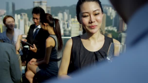 multi ethnic business people on rooftop
