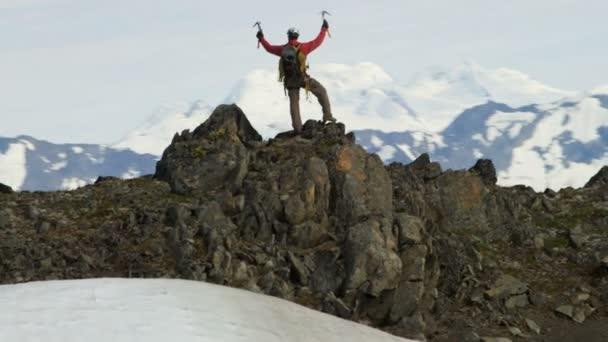 mountain climber enjoying success on high peak