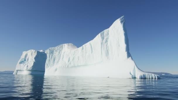huge icebergs floating in water