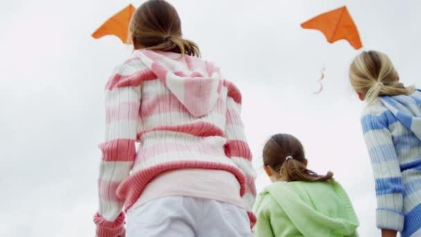 Girls with kite on beach