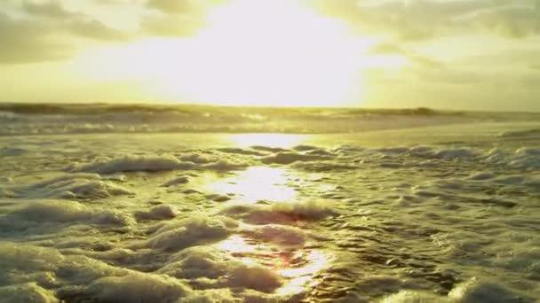 Golden Sunset Over Ocean Waves