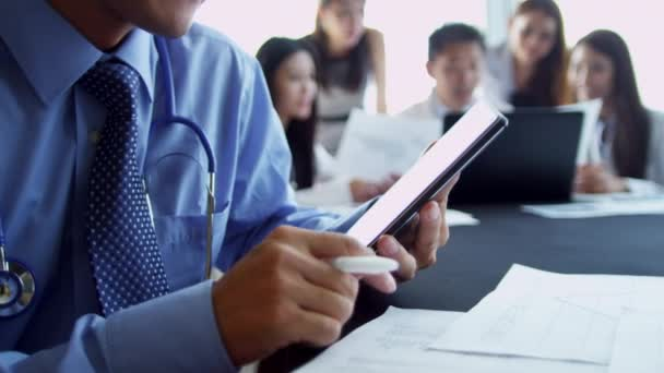 Asian medical executives in hospital boardroom