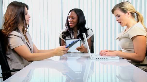 businesswomen having meeting in modern boardroom